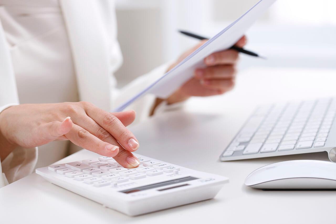 Woman work on white calculator
